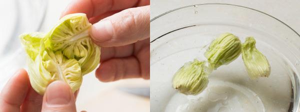 ふきのとうの汚れているガクをむいて、丸のまま手で割き、水にさらすところ