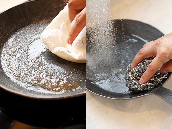鉄のフライパンを塩でこすり、洗い流す様子