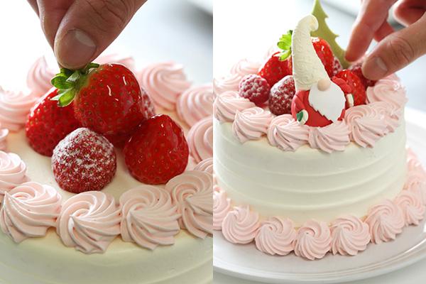 ケーキにフルーツとオーナメントを飾る様子